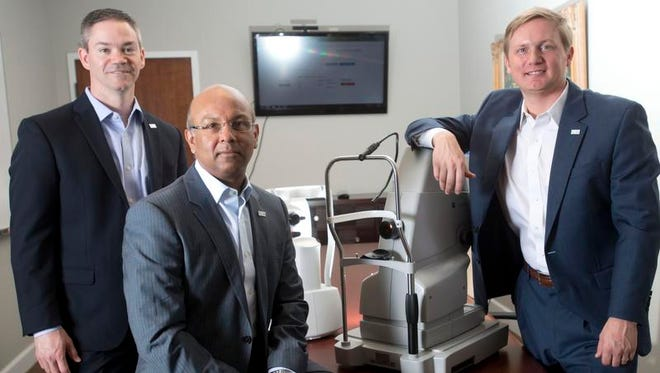 From left, Intelligent Retinal Imaging Systems CEO Jason Crawford, founder Sunil Gupta and Director Chad Henderson. The company was named Tuesday as a recipient in this year's Microsoft Health Innovation Awards.