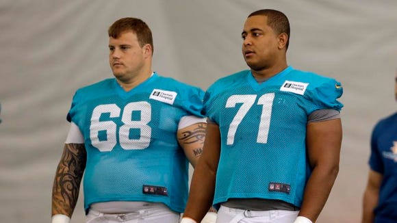 Guard Richie Incognito, left, and tackle Jonathan Martin stand on the practice field in July. Martin left the team in late October after being subjected to bullying and hazing and Incognito was suspended days later.