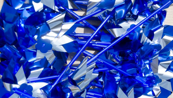 Blue and silver pinwheels are used nationwide as a symbol of abused children.