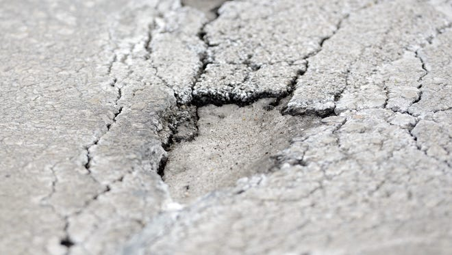 Broken pavement in the 2500 block of Riverside Drive in Allouez.