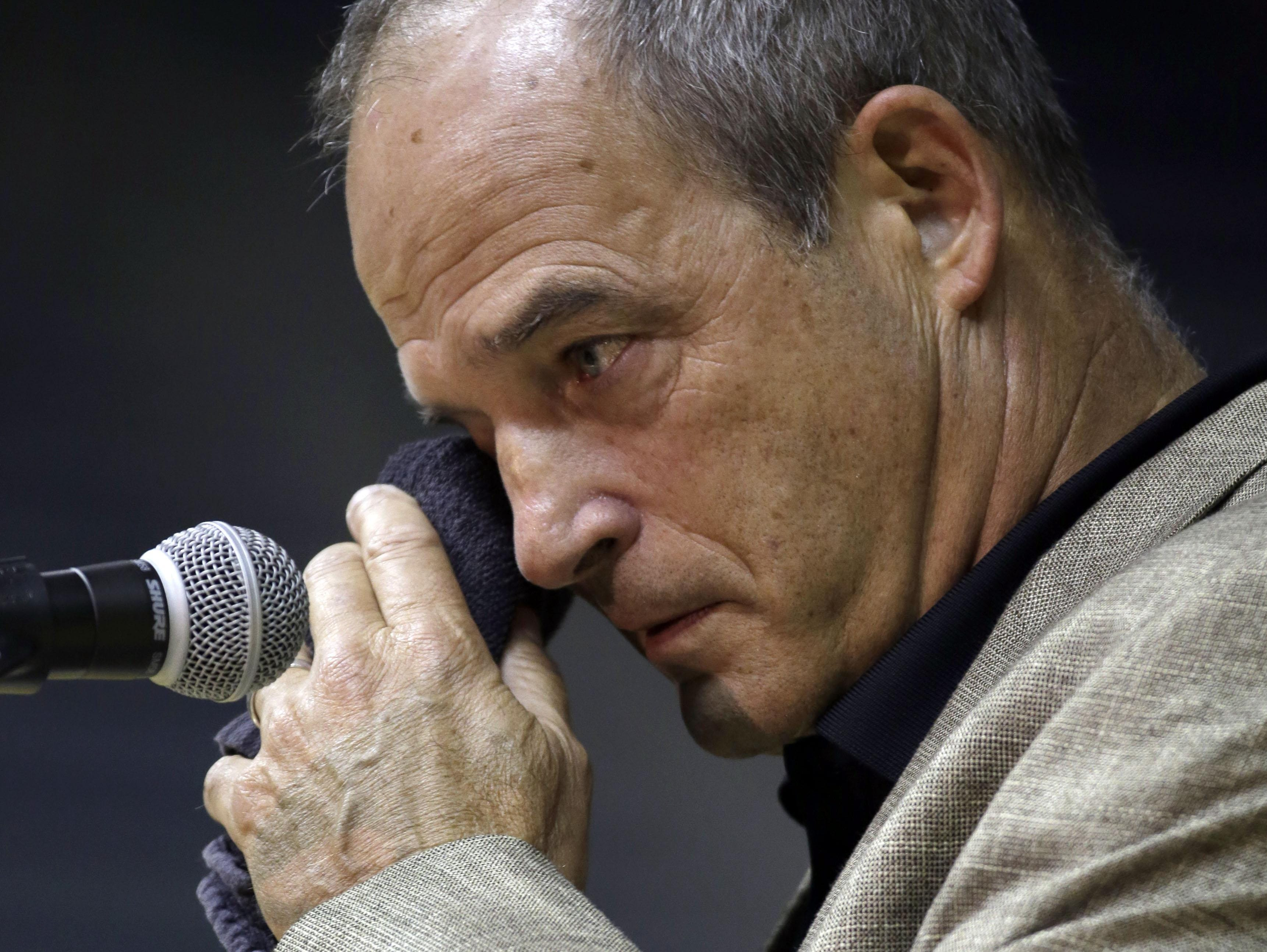 Tigers head coach Gary Pinkel wipes his eye as he speaks during a news conference Monday in Columbia. Pinkel announced he will resign following the 2015 season.