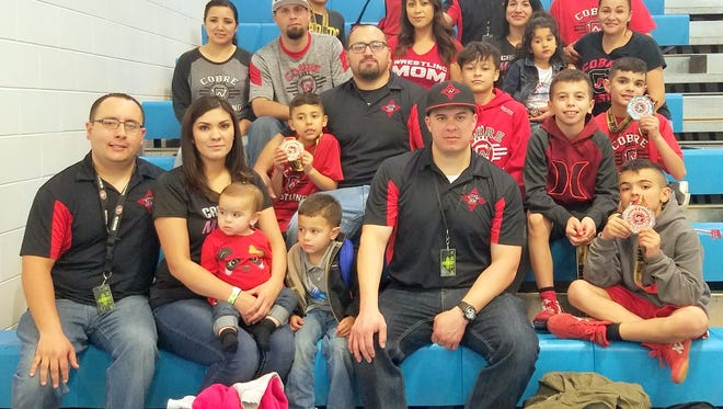 The Cobre Junior Wrestling Program has a chance to pose for a photo after wrestling in the New Mexico Junior Wrestling State Championships.