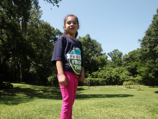 Amelie Gomez, 6, will be working with Project Front Yard to learn about Vermilion River cleanup and conservation. She is pictured Wednesday, June 3, 2015, outside the Episcopal School of Acadiana Lafayette campus, which overlooks the Vermilion River.