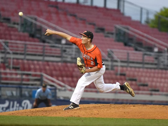 Palmyra senior Zach Yingst throws towards home during the District Three Class AAA title game Thursday at Reading's First Energy Stadium. The Cougars lost to Hamburg, 7-0.