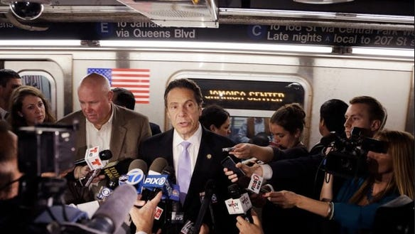 Gov. Andrew Cuomo holds a news conference on a subway