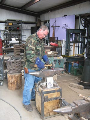 Student Tom Orban working during a class