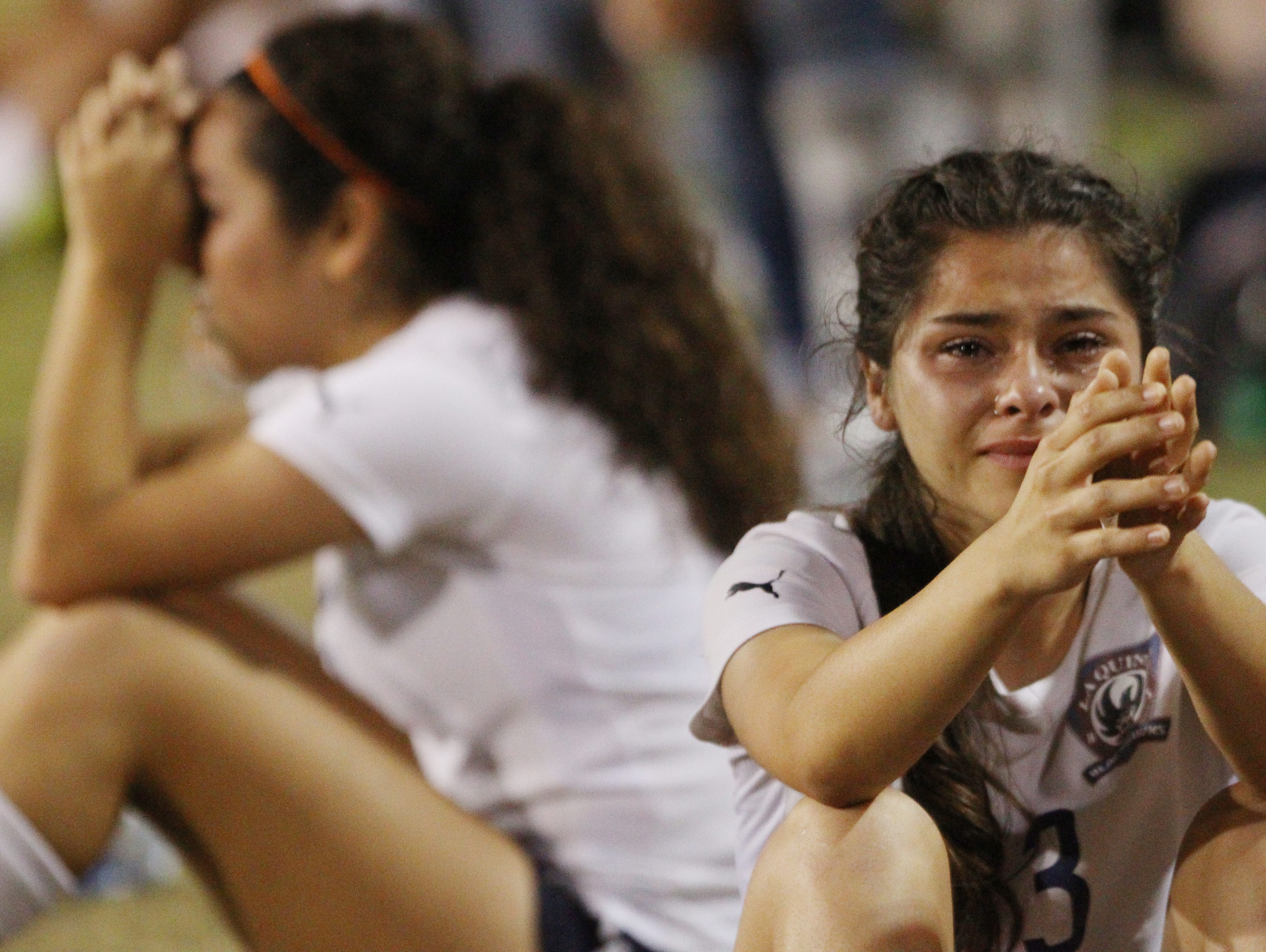 From left, Marcela Gallo and Jiana Guerrero are dejected as their La Quinta High School girls' soccer team is unable to come back down 1 goal against Paloma Valley High School during their second round CIF game at La Quinta on February 21, 2017