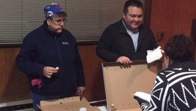 Charlotte Community Association member Sue Kroll and CCA President Jonathan Hardin passed out donuts and pizza to a record crowd the their annual tree lighting.