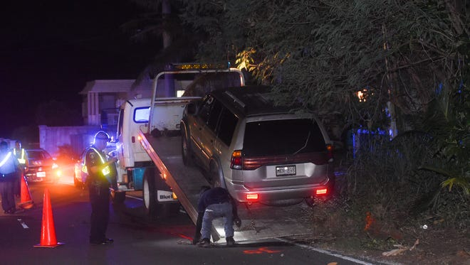 A Mitsubishi Montero involved in an auto-pedestrian crash is towed on the northbound shoulder of Route 10 in Barrigada on June 11, 2017.