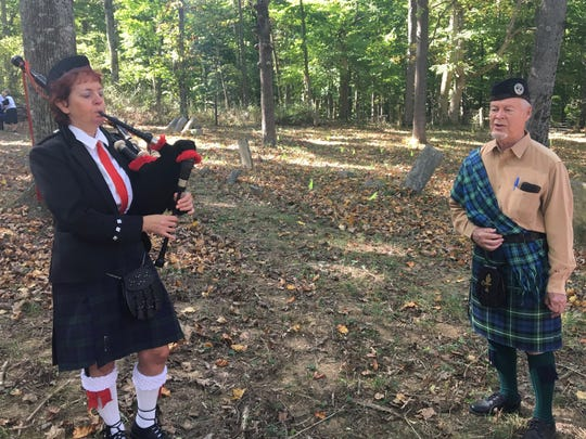Kathy Boyer plays the bagpipes and Reverdy Wright sings