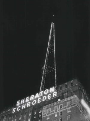 The sign atop the Sheraton-Schroeder Hotel in downtown Milwaukee gets some new competition when 300 light bulbs were installed on the television tower atop the hotel. This photo was published in the Oct. 17, 1966, Milwaukee Journal. (The hotel later became the Marc Plaza and then the Hilton Milwaukee City Center.)