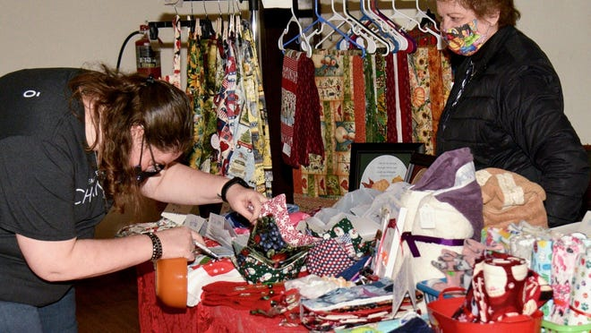 Marie Bonilla, left, picks out soup bowl holders from vendor Lois Shaw during the 4th Annual Last Chance Christmas Shopping Vendor Fair held at the auditorium in gypsum on Thursday evening.