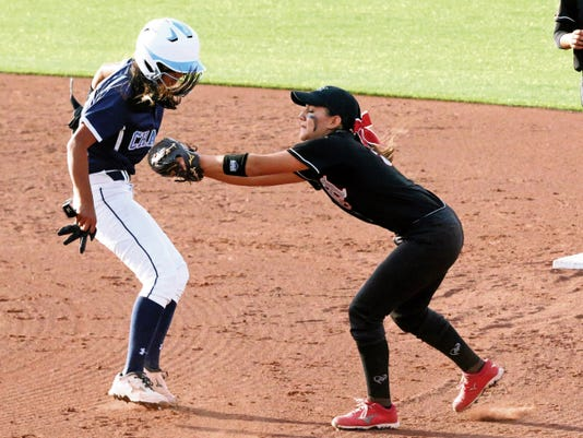 Rudy Gutierrez—El Paso Times Hanks infielder Dulce Gardea, right, tags Chapin's Jazmyne Armendariz before throwing to first base for a double play Friday night during their Class 5A regional quarterfinals game at the Helen Of Troy softball complex on the UTEP campus.