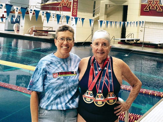 Courtesy Photo   Pamela Gulbrandson, left, and Yenny van Dinter takes time out by the pool durng the 2015 Senior Olympic Games in Minneapolis, MN.