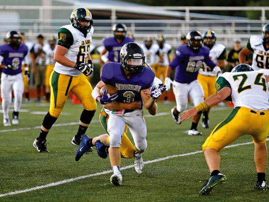 Kirtland Central's Aiden Cockrell breaks away from an attempted tackle during Friday's game against Los Alamos at Bronco Stadium.