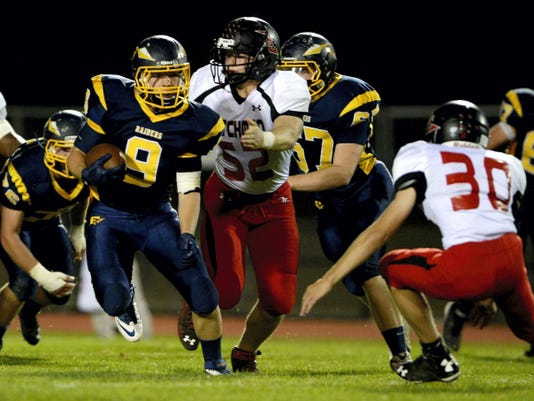 Elco 's Travis Zimmerman looks for running room against Annville-Cleona last season during the Raiders' eventual 42-21 loss at home.