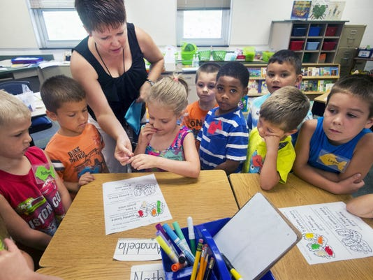 Teacher Meghan Busby asks the children to gather around her to explain the work sheet. Red Lion Kinder Cubs camp at Pleasant View Elementary School in Windsor Township. It prepares incoming kindergarten students for school with a focus is on language development, social skills and development of gross and fine motor skills.