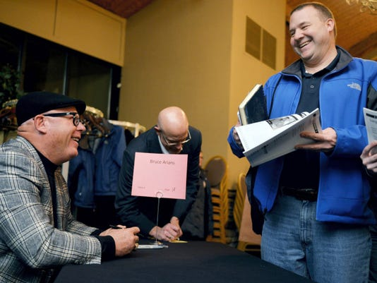 Arizona Cardinals head coach and William Penn graduate Bruce Arians, left, chats with Tom Balanda of Manchester Township after signing an autograph Thursday at the 50th York Area Sports Night at Heritage Hills Golf Resort.