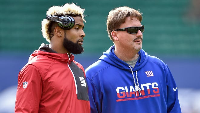 Giants wide receiver Odell Beckham (left) talks with head coach Ben McAdoo before Sunday's  game in London against the Los Angeles Rams.