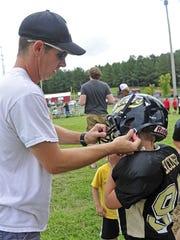 Jack Buckner, left, helps his son Evan, a Mt. Juliet