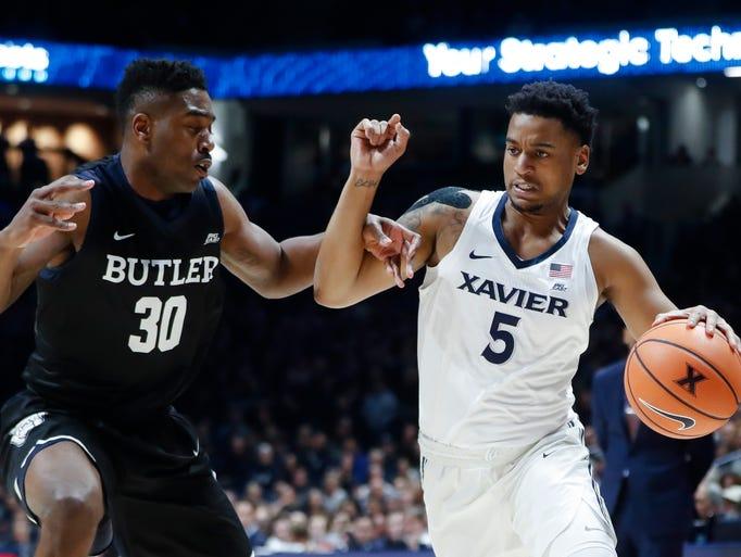 Xavier's Trevon Bluiett (5) drives against Butler's