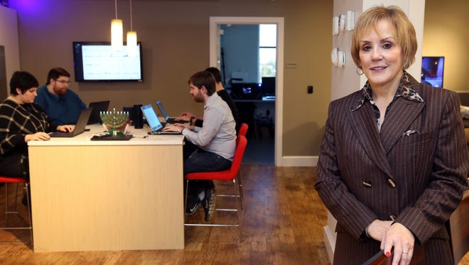 Sue Nokes, senior vice president of customer solutions with Asurion, is pictured in a mockup of a home environment at Asurion offices. The area is used to test various hardware and software products that would be found in a customer's home.