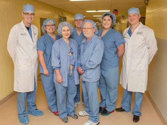 The surgical team at St. Joseph Mercy Livingston who performed the hospital's first bariatric surgeries on twin sisters pose for a photo just before the procedure.