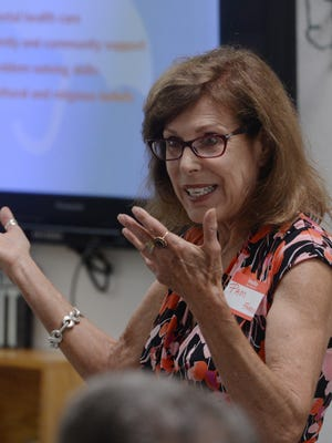 Pam Farkas leads a suicide prevention workshop put by the American Foundation for Suicide Prevention, Engage, the Southeast Ventura County YMCA and Art Trek. As a follow-up, an Out of the Darkness community walk is scheduled for Saturday.