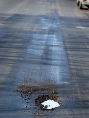 Potholes are becoming apparent in the 2500 block of N. 8th Street Thursday March 31, 2016 in Sheboygan.