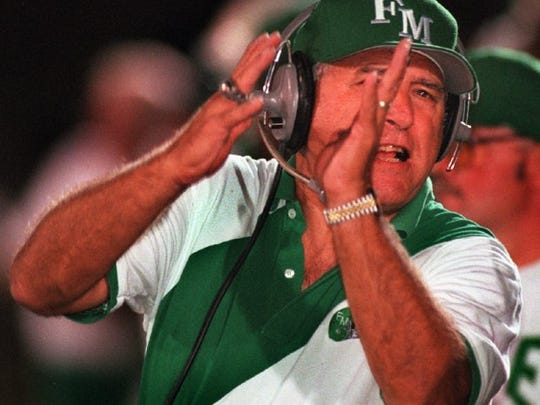 Fort Myers High football coach Sam Sirianni calls a play on the sidelines during a game against North Fort Myers High.