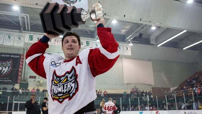 Prowlers players celebrate winning the Commissioner's Cup playoffs Friday, April 22, 2016 at McMorran Arena.