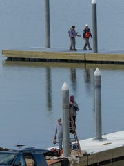 Marine Specialties workers add to the existing dock