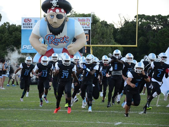 Here come the Rockledge High School Raiders onto the field Friday night in their home game against Palm Bay.