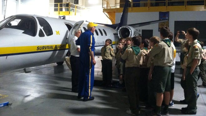 Boy Scouts from Troop 362 of Howell check out a University of Michigan Survival Flight jet.