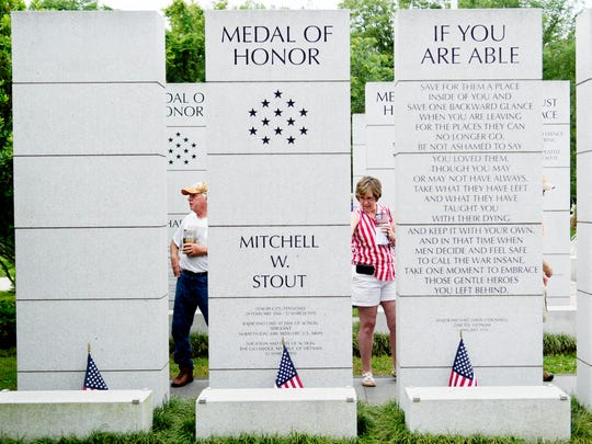 Attendees walk through the memorial during an observance and remembrance of veterans on Memorial Day at the East Tennessee Veterans Memorial in Knoxville, Tennessee on Monday, May 29, 2017.