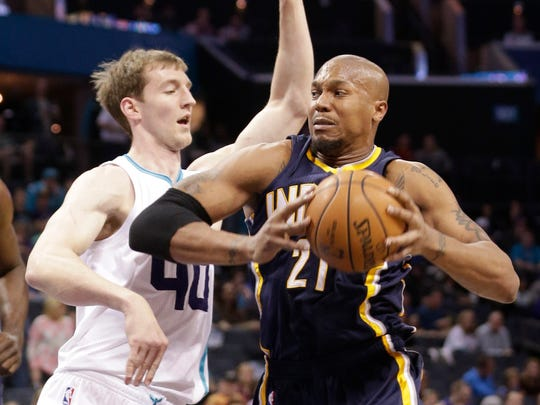 Charlotte Hornets' Cody Zeller (40) guards Indiana Pacers' David West (21) during the first half in Charlotte, N.C., Feb. 8, 2015.