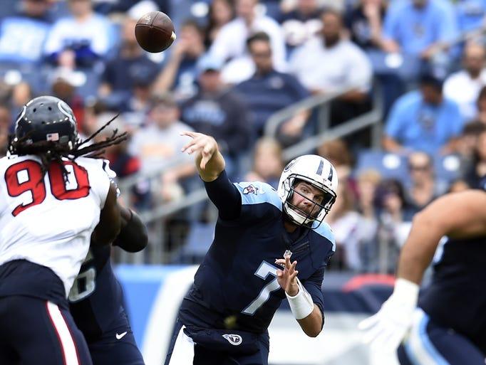Titans quarterback Zach Mettenberger throws a pass