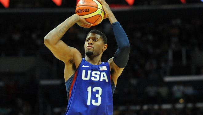 USA forward Paul George (13) shoots the ball against China in the first half during an exhibition basketball game at Staples Center.