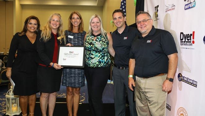 The May Dyer Difference Award was presented at the 10th anniversary of the Treasure Coast Business Summit. Pictured are WPBF Anchor Felicia Rodriguez, left, Cindy Bruin, Julia Keenan and Keri Hughes. representing Indian River State College Foundation, and Jonathan Hardie and Jonathan Holmes, from Dyer Chevrolet Fort Pierce and Dyer Chevrolet Mazda Subaru in Vero Beach.