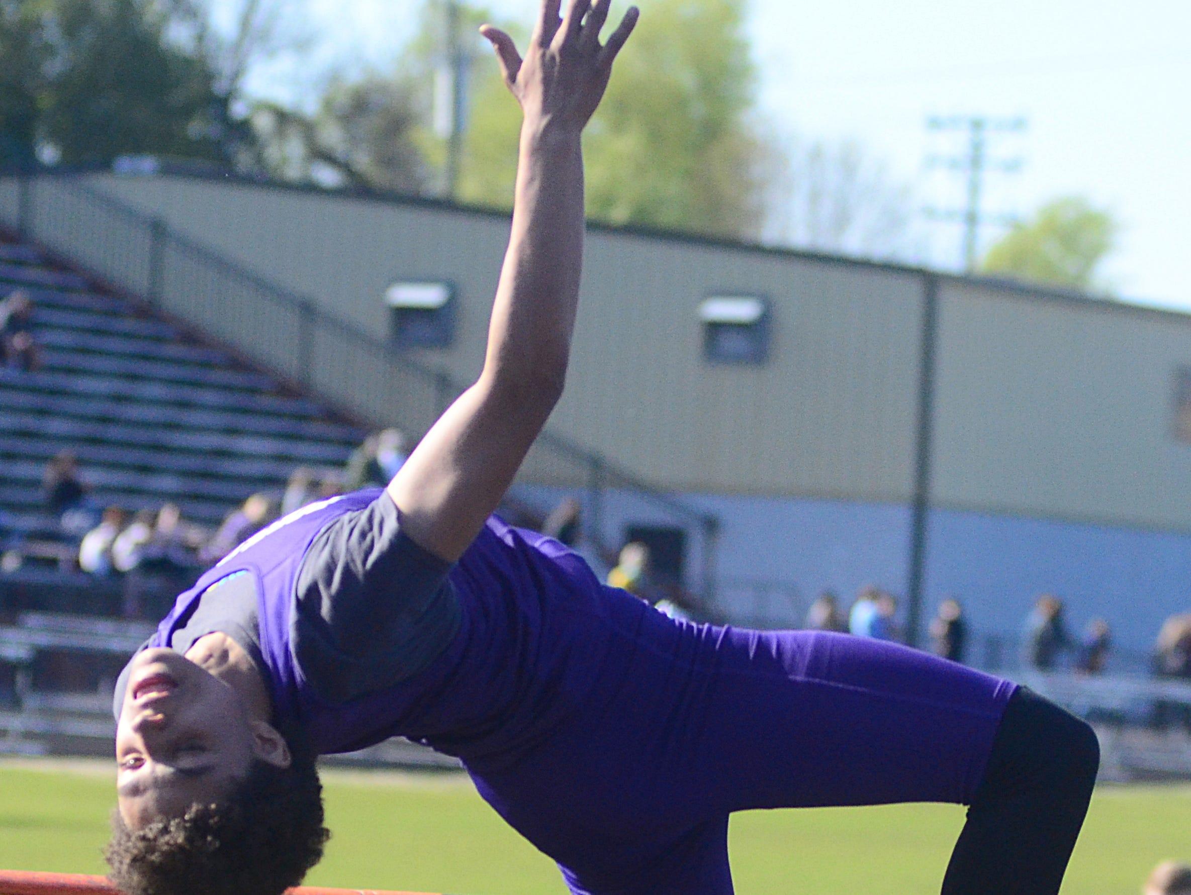 Portland High freshman Shai Sumpter-Bey makes an attempt in the boys' high jump.