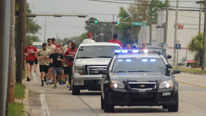 Police from Pensacola-area agencies took to the streets Monday, March 27, 2017, to raise awareness for Special Olympics Florida by carrying the event's torch.