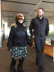 """Harriet Baskas - in 30 pounds of """"aging suit"""" apparatus"""