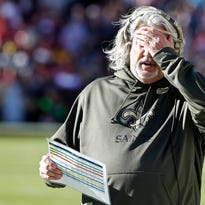 New Orleans Saints defensive coordinator Rob Ryan reacts on the sidelines against the Washington Redskins in the second quarter at FedEx Field. The Redskins won 47-14.