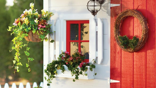 Add little touches to your shed, like a flower pot or light fixtures.