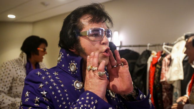 Jonny smooths out his sideburns before his performance. Johnny Lovett, whose late dad was one of the first and most famous Elvis impersonators, performed Saturday, June 25, during the Elvis Tribute ArtistsÕ Contest qualifying round in the casinoÕs Seminole Center. His father recently passed away and to honor him Johnny has taken up impersonating Elvis again.