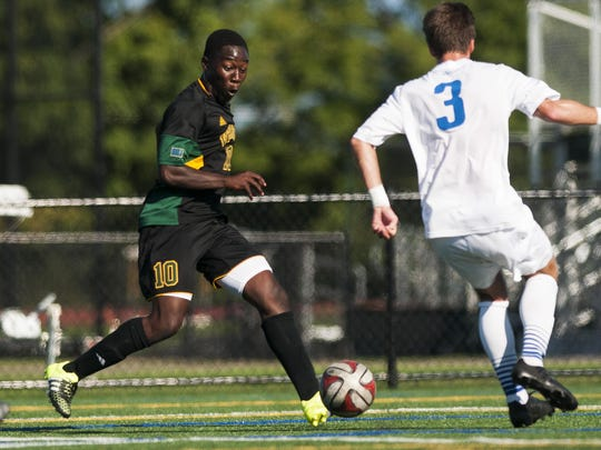 UVM's Bernard Yeboah (10) kicks the ball during the men's soccer game against UNC-Asheville at Virtue Field on Sept. 11. Yeboah is tied for second on Vermont with five goals this year.