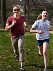 Hope, 12, and her father, Garrett Stangel, demonstrate