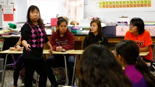 Science teacher Cynthia Montano Brown talks to her students on Wednesday at Newcomb Middle School.
