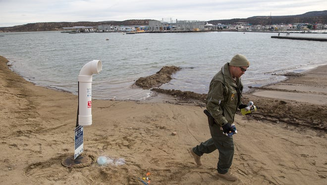 Navajo Lake State Park Superintendent Christopher Smith cleans out a monofilament fishing line recycling unit on Jan. 12 at the park.