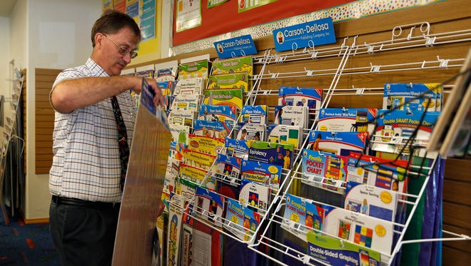 Charles Dobey, owner of Teach the Children, works on Tuesday in his store at 1618 E. 20th St. in Farmington.